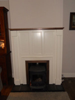 Gloss white with walnut trim fire surround