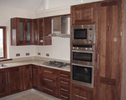 style kitchen in walnut and stainless steel